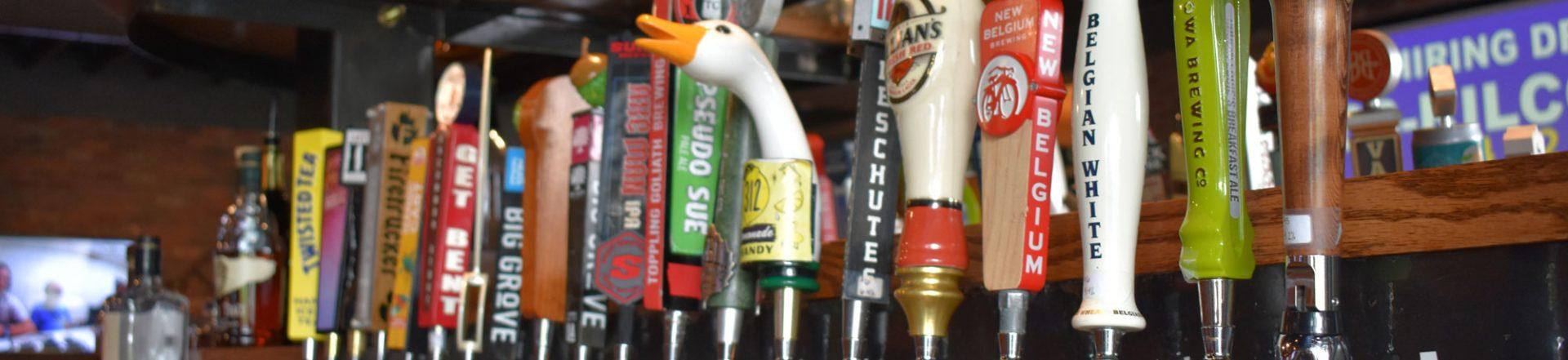 Line of beer tap handles.